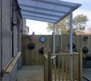 White PVC awning fitted above decking