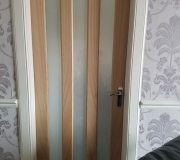 Oak Vertical glazed three panel internal door