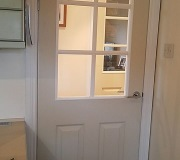 White glazed internal door with modern chrome handles