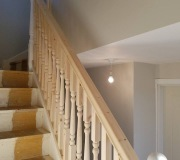 Redwood staircase with turned newel posts and spindles