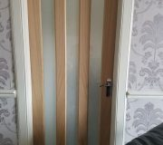 Oak Vertical glazed three panel internal door