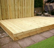 Decking platform with backdrop
